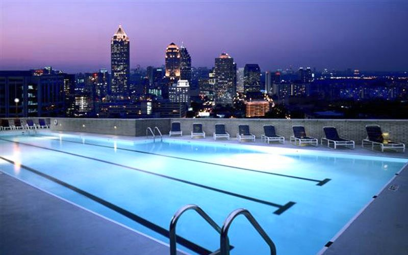 a rooftop pool with incredible city views we ll take it the rh pinterest com