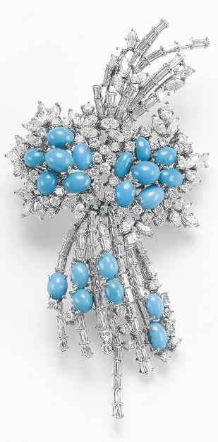 A Turquoise and Diamond Brooch  Designed as a baguette, circular and marquise-cut diamond spray, accented by cabochon turquoise spray, mounted in 18K white gold, length 3 1/2 inches.