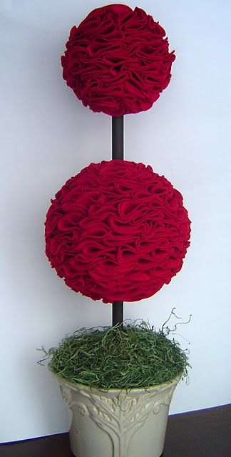 Felt Topiary like this idea. Don't have to clear any surfaces to put a decoration. Just take it out and set it near a door way or in a corner.