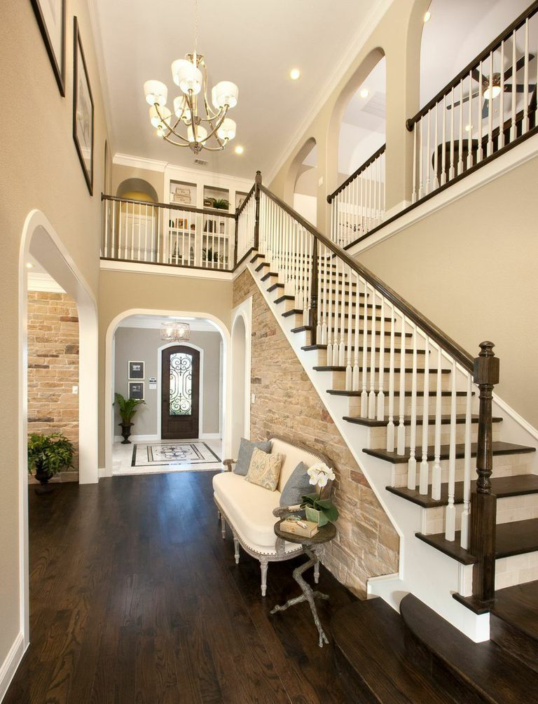 Foyer Staircase Quest : An exposed brick wall under the staircase in foyer