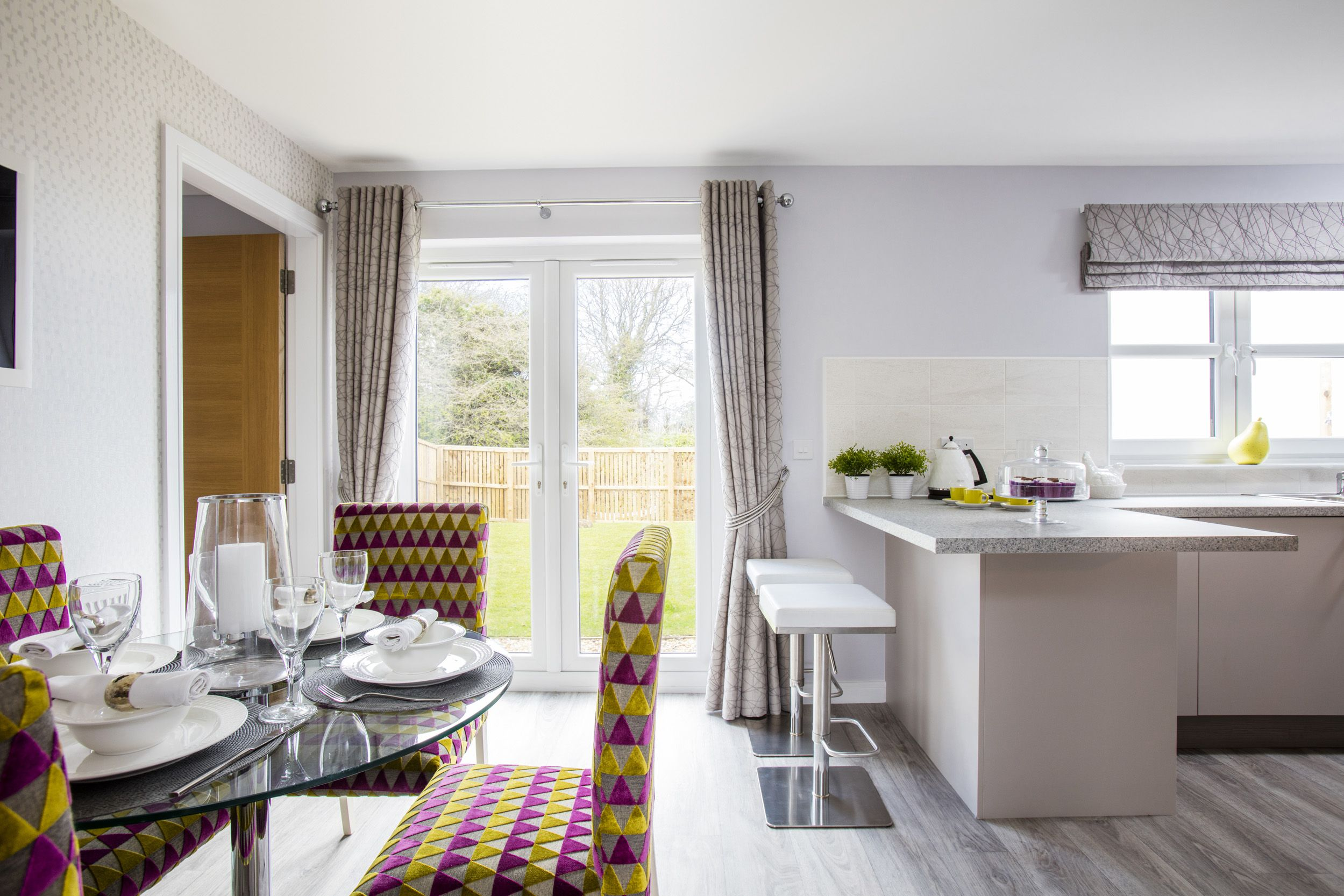 French doors allow plenty of light into this open plan kitchen ...