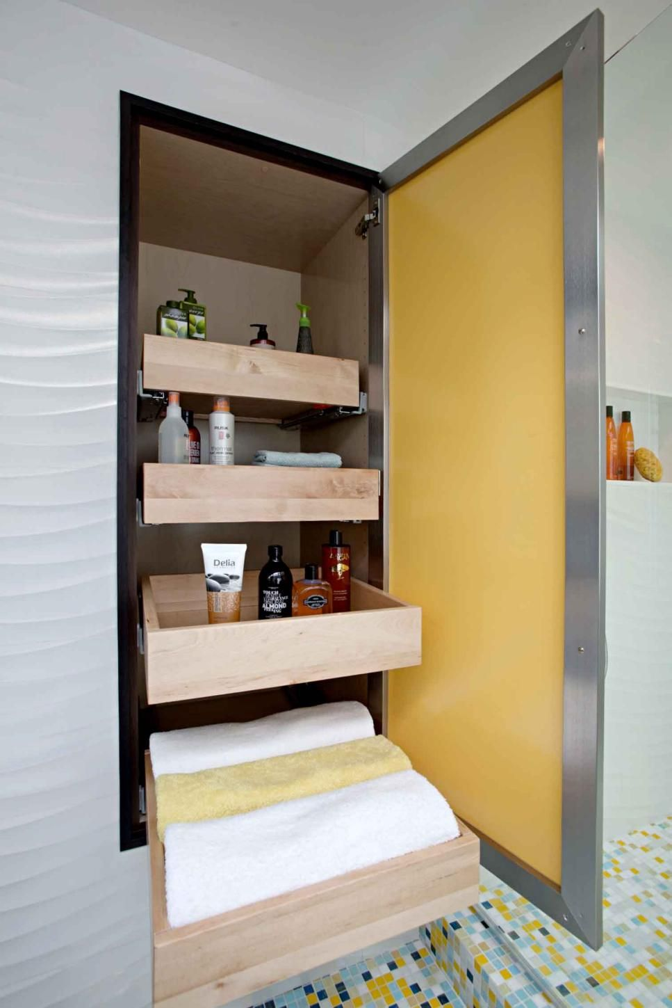 A bright yellow door conceals a large cabinet space built into the