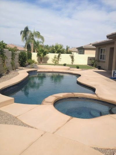 Single Level Spa And Freeform Pool With 6 Raised Bond Beam Colored Concrete Deck American