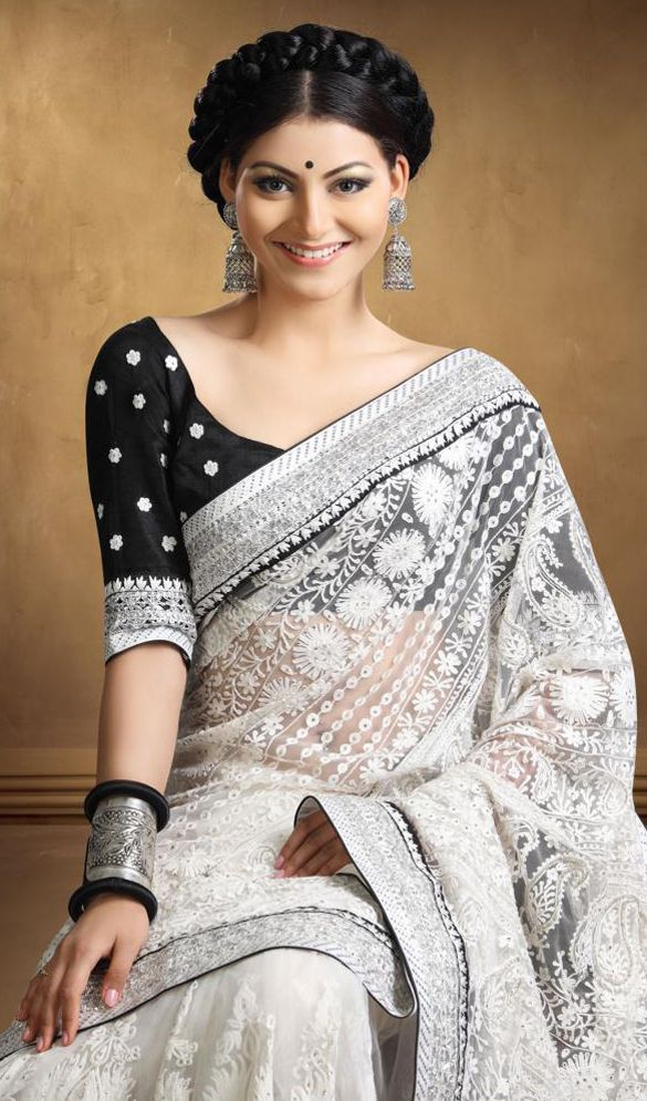 b7d340da24 A black blouse and white sari combination looks chic and effortless...like  the minimalist soft make-up, the tiny black bindi, the long jhumka earrings  and ...