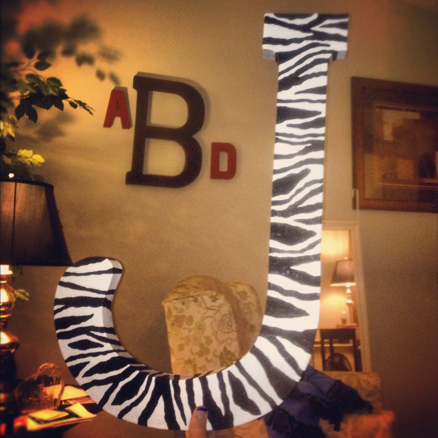 Painted zebra J for my nieces bedroom.