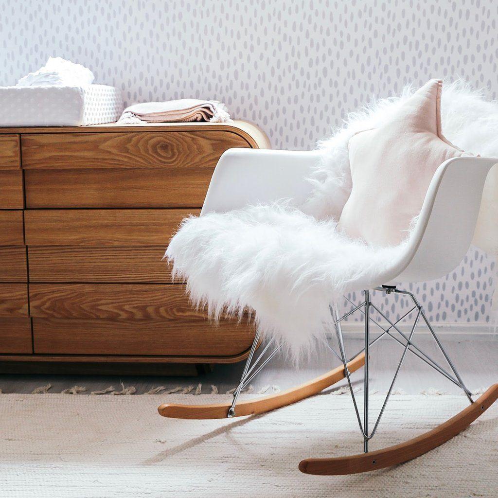 nursery rocking chair with sheepskin rug and star shape pillow rh pinterest com