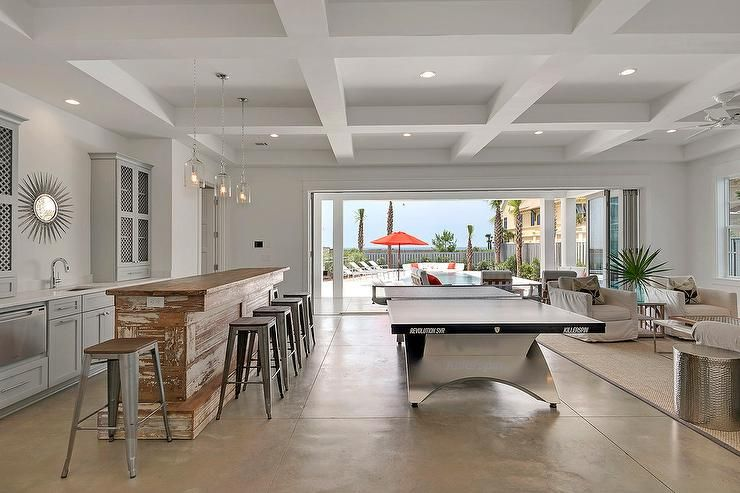 well appointed beach style game room boasts corsica 1 light pendants rh pinterest com