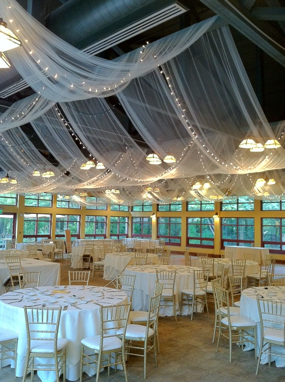 Fabric draping and twinkle lights in the
