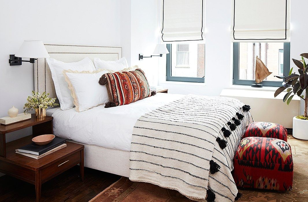 Textiles carry the eye in the white walled