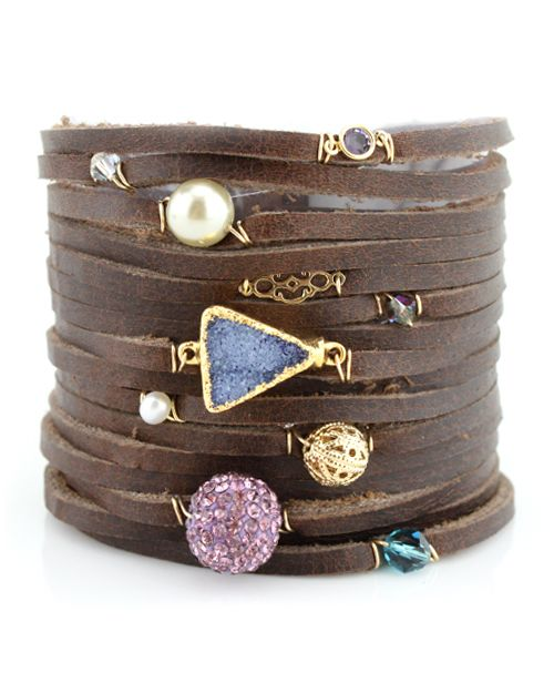I am such a fan of LoLo Jewels! Designer, Stephanie Curtis, a fellow Texan, designs these amazing pieces! Available at Stanley Korshak - LoLo Jewels Brown Leather Charm Bracelet (and she's a great gal!)