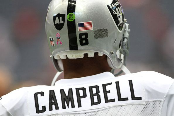 Quarterback Jason Campbell #8 of the Oakland Raiders who is wearing a Black AL in the form of a Raider shield on the back of helmet warms up before playing against the Houston Texans on October 9, 2011 at Reliant Stadium in Houston, Texas. Raider owner, Al Davis died at age 82 at his home Saturday morning.