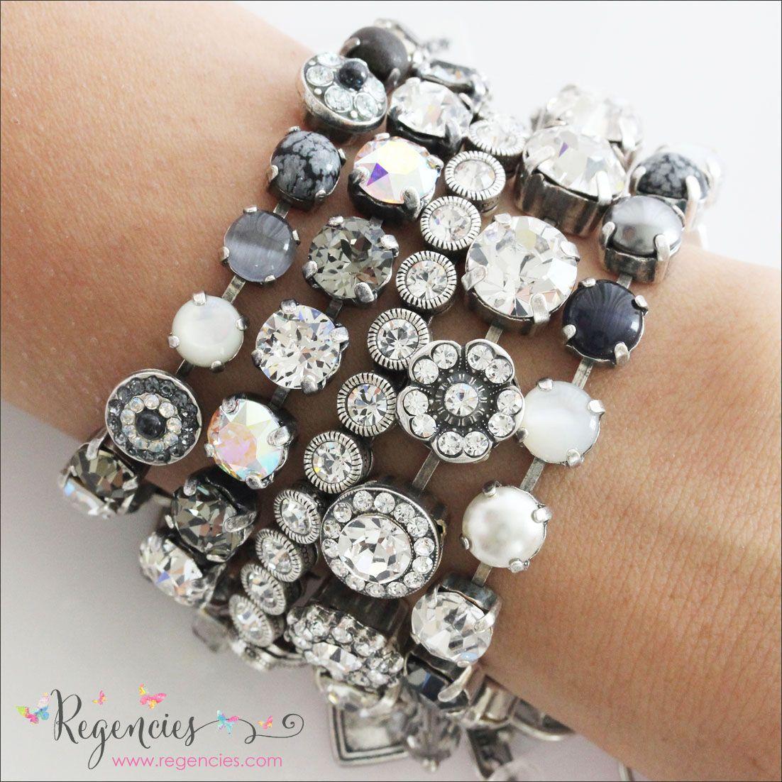 Black and white Swarovski bracelet stack. Left to right: Mariana $74.00, Catherine Popesco $70.00, Patricia Locke $175.00, Mariana $136.00, and Mariana $74.00