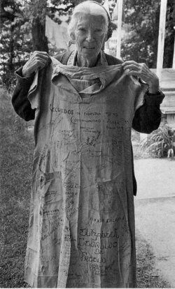Catholic Worker crusader Dorothy Day with her prison dress [covered with autographs!] On November 1917 Day went to prison for being one of forty women in front of the White House protesting women's exclusion from the electorate. Arriving at a rural workhouse, the women were roughly handled. The women responded with a hunger strike. Finally they were freed by presidential order.