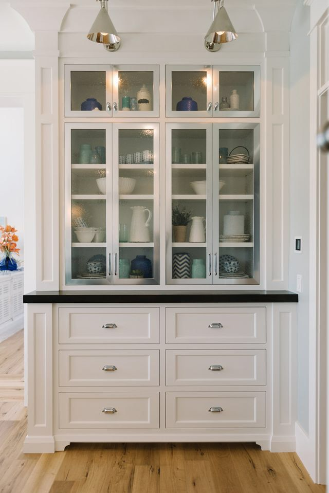 great built in cabinet with glassware storage above