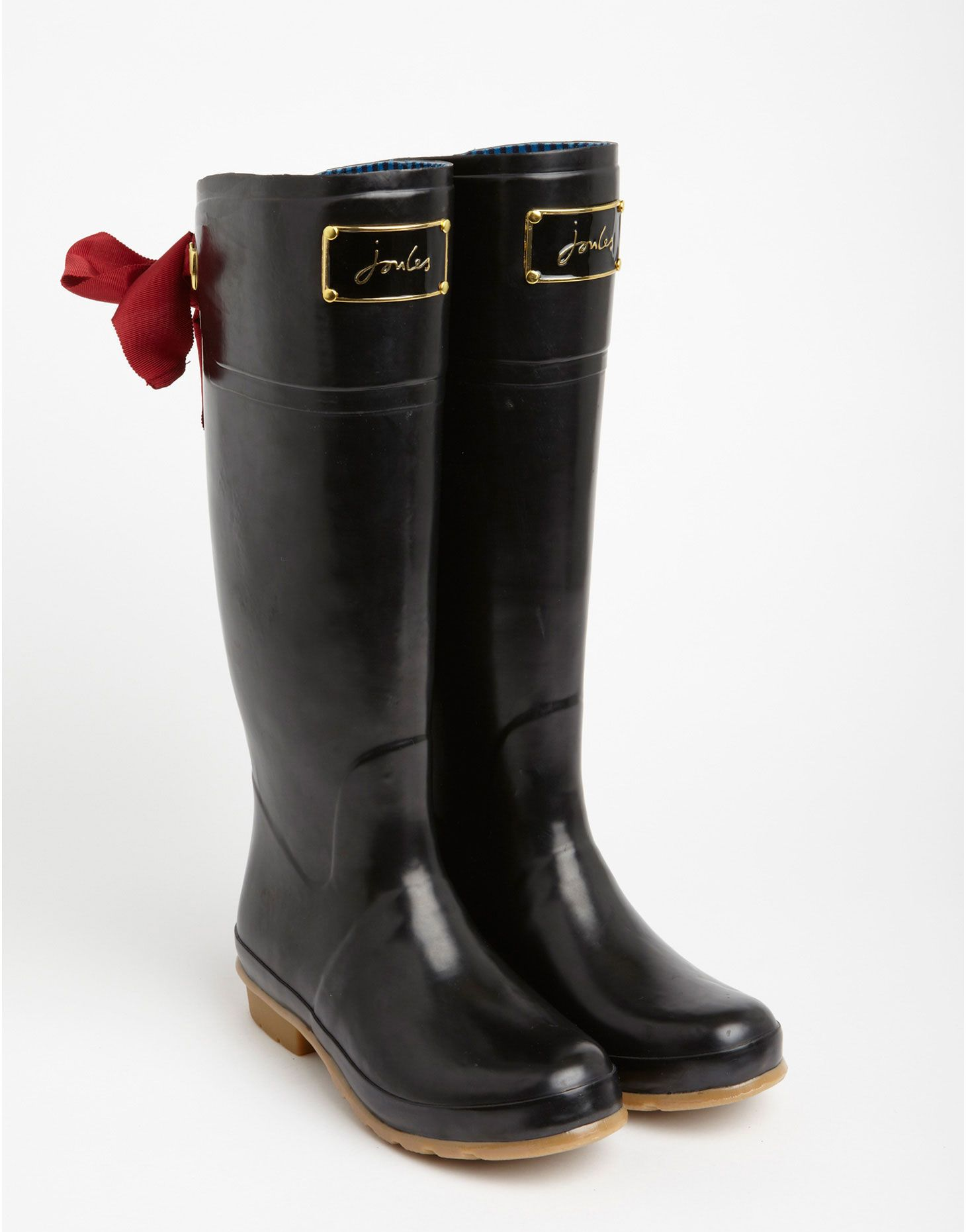 LOVE these black evedon rain boots. the red bow is a perfect ...