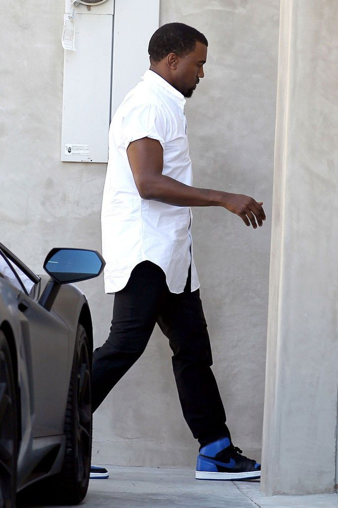 4adfc70360c27f Kanye West wearing Air Jordan 1 Black Royal