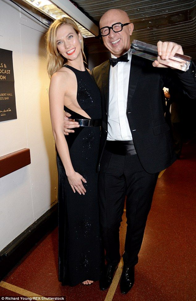 All smiles: Karlie and Marco coordinated each other in their demure black ensembles