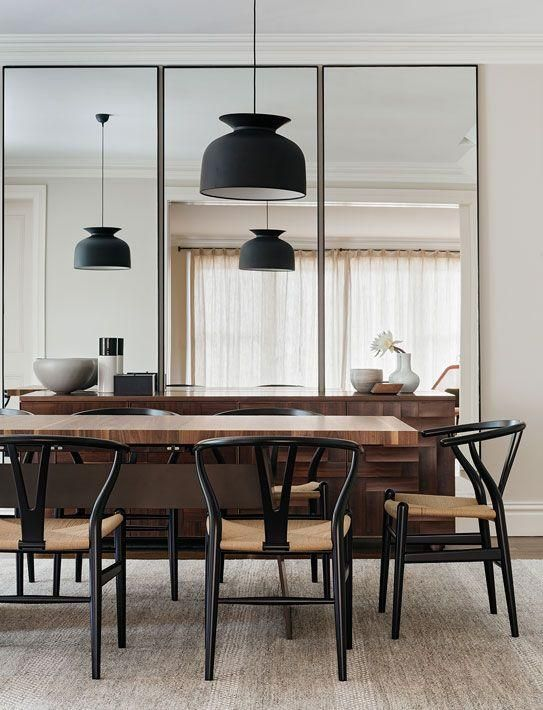 Modern Dining Space With Black Pendant Lights, Black Midcentury Dining  Chairs And Floor To Ceiling