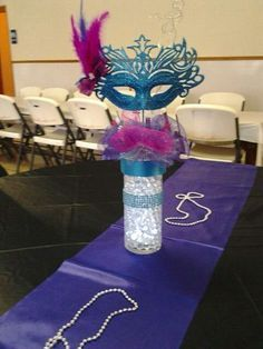 all those masks i have over cool centerpiece idea for a masquerade rh pinterest com