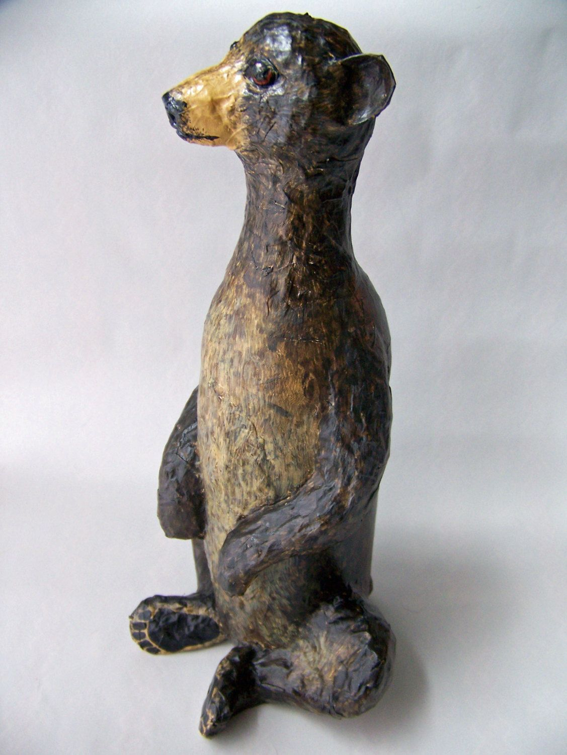 Bear sculpture made from paper mache and wine bottle