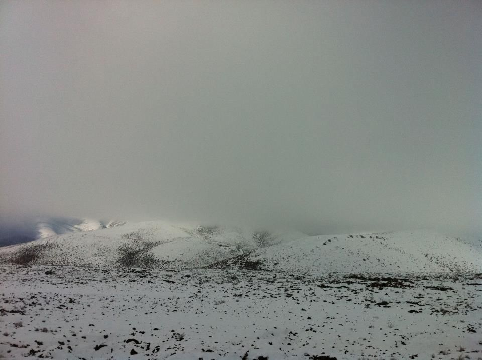 Basaltic rock covered in cloud and snow at the Craters of the Moon National Monument in Idaho.