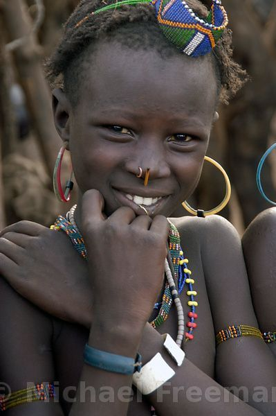 Michael Freeman Photography   A young Jie girl in southeastern Sudan. The Jie tribe are pastoralists, with cattle the primary wealth, and are related to the Turkana of Kenya. This girl is from Nawiaporo village at the foot of the Boma Plateau, close to the Ethiopian border.