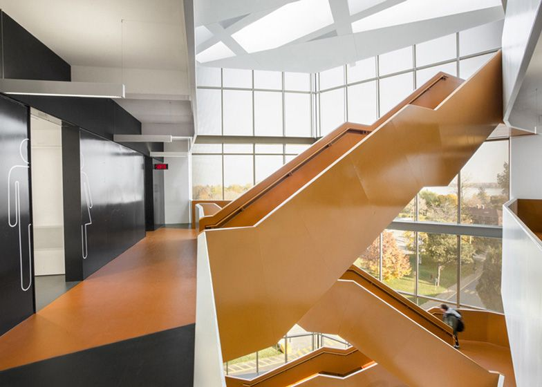 grand orange staircase ascends through science faculty by saucier rh pinterest de