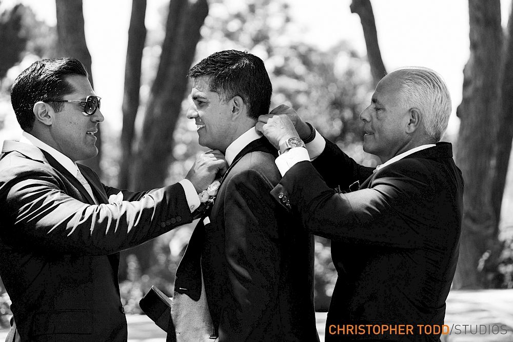 affordable wedding photographers in los angeles%0A black and white photo of groom with best man fixing tux at wayfarers chapel wedding  photography
