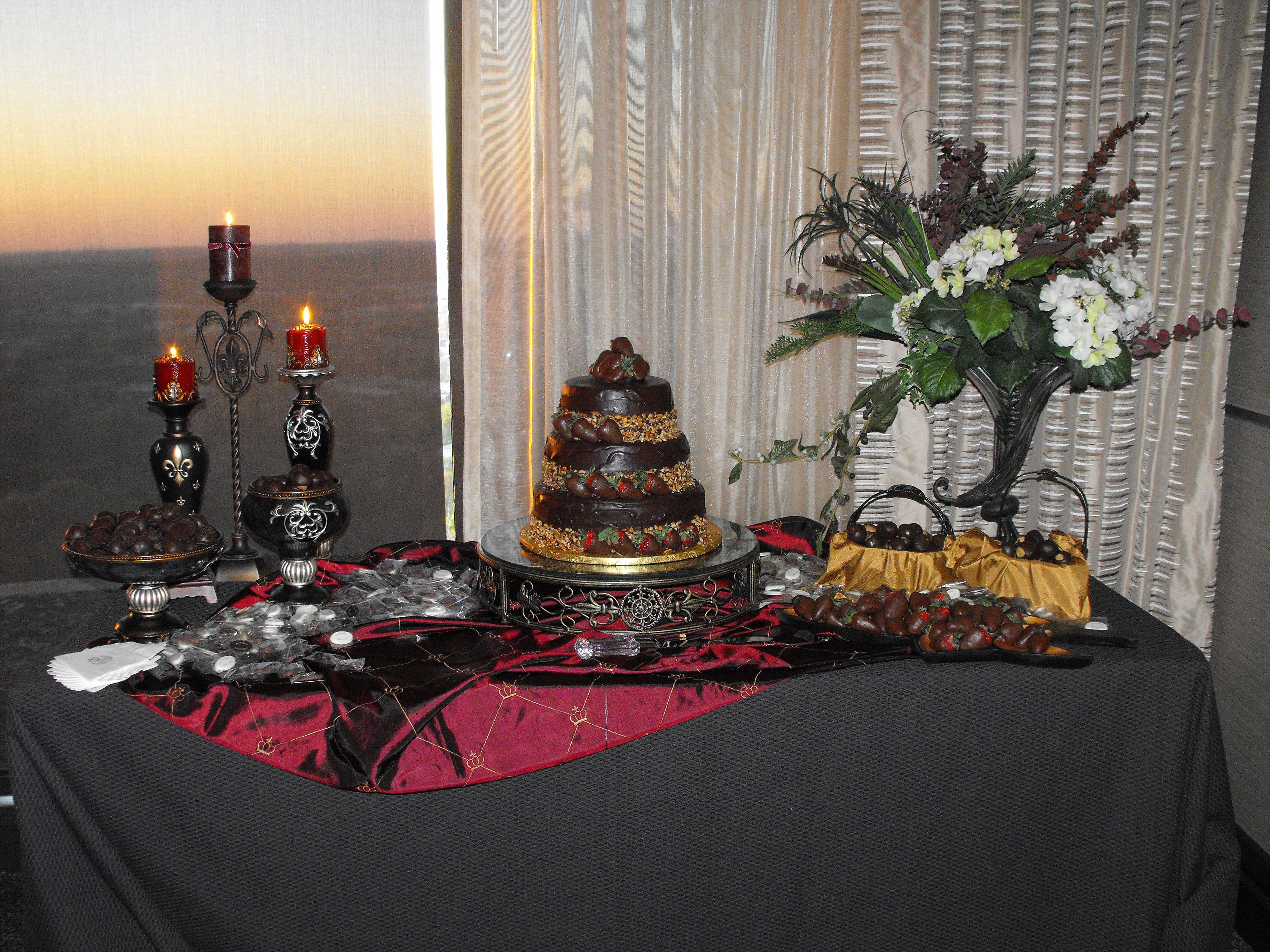 Grooms Cake Display. To create this cakestand for my son's wedding, I bought a small round metal table, cut off the legs, then had a glass top made to fit. Chocolate cake, Oreo truffles, buckeyes and chocolate dipped strawberrries - yum!