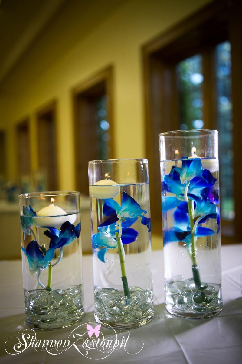 blue flowers in water floating candles blue