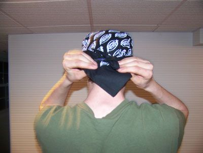 How to Fold a Bandanna on Your Head: Adjust the Fabric