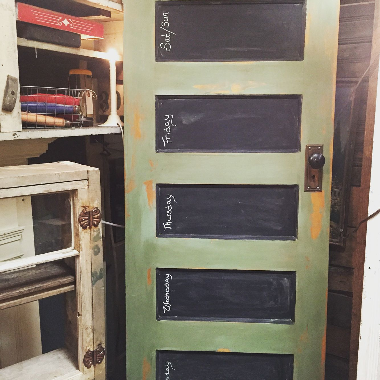 Awesome antique door chalk painted with Maison Blanche Mardi Gras and antiques with dark brown wax and used wrought iron  MB paint un waxed to create chalkboard centers. It can be hung vertical or horizontal.