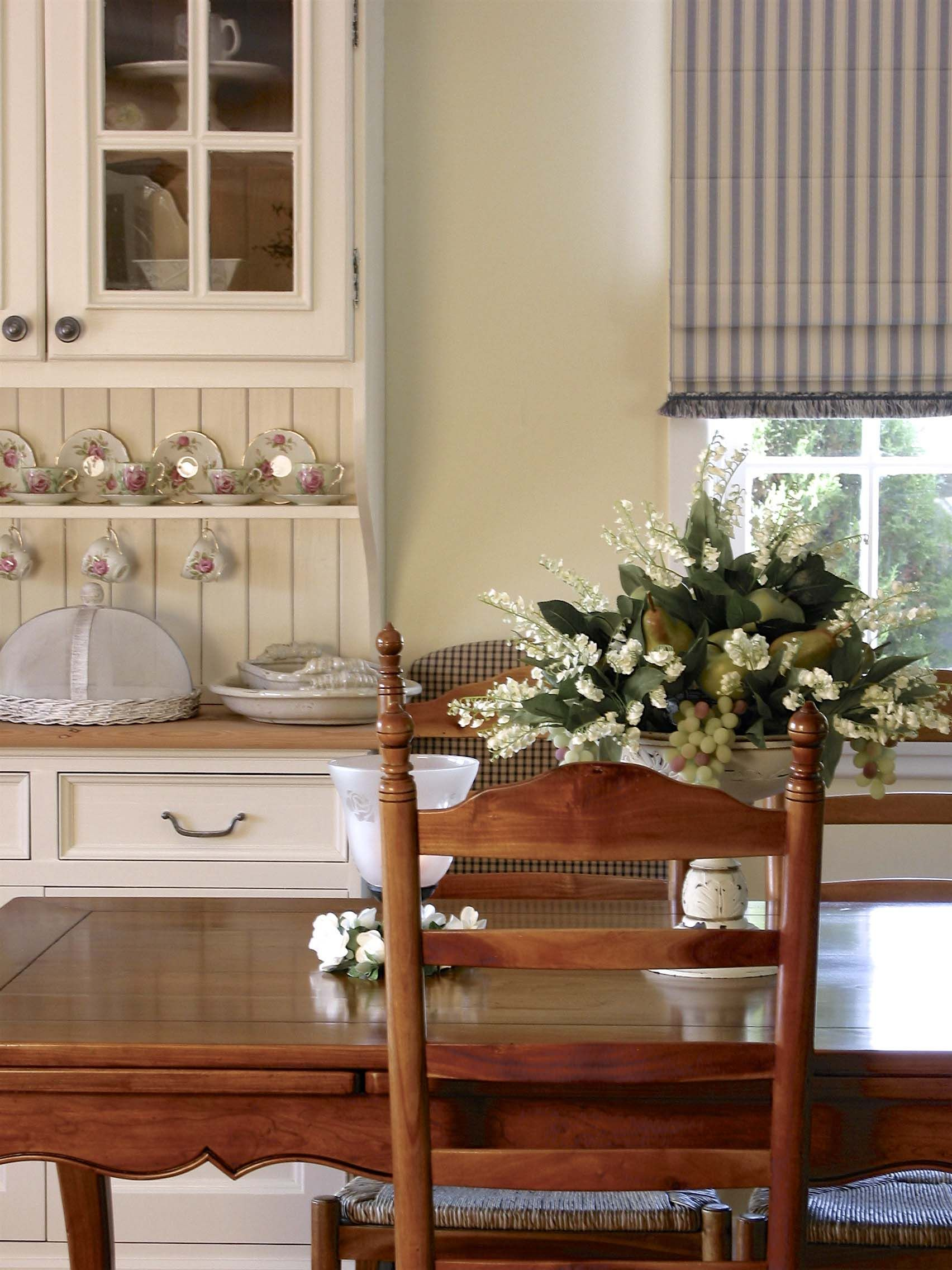 This French farmhouse kitchen with tiled benchtop, plate