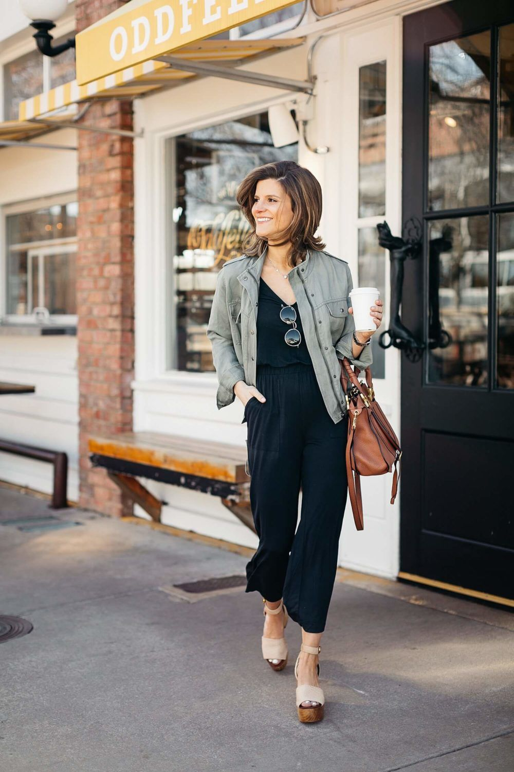 c6a7f6eff1 black jumpsuit paired with olive green utility jacket military jacket  outfit  fall  ootd  style