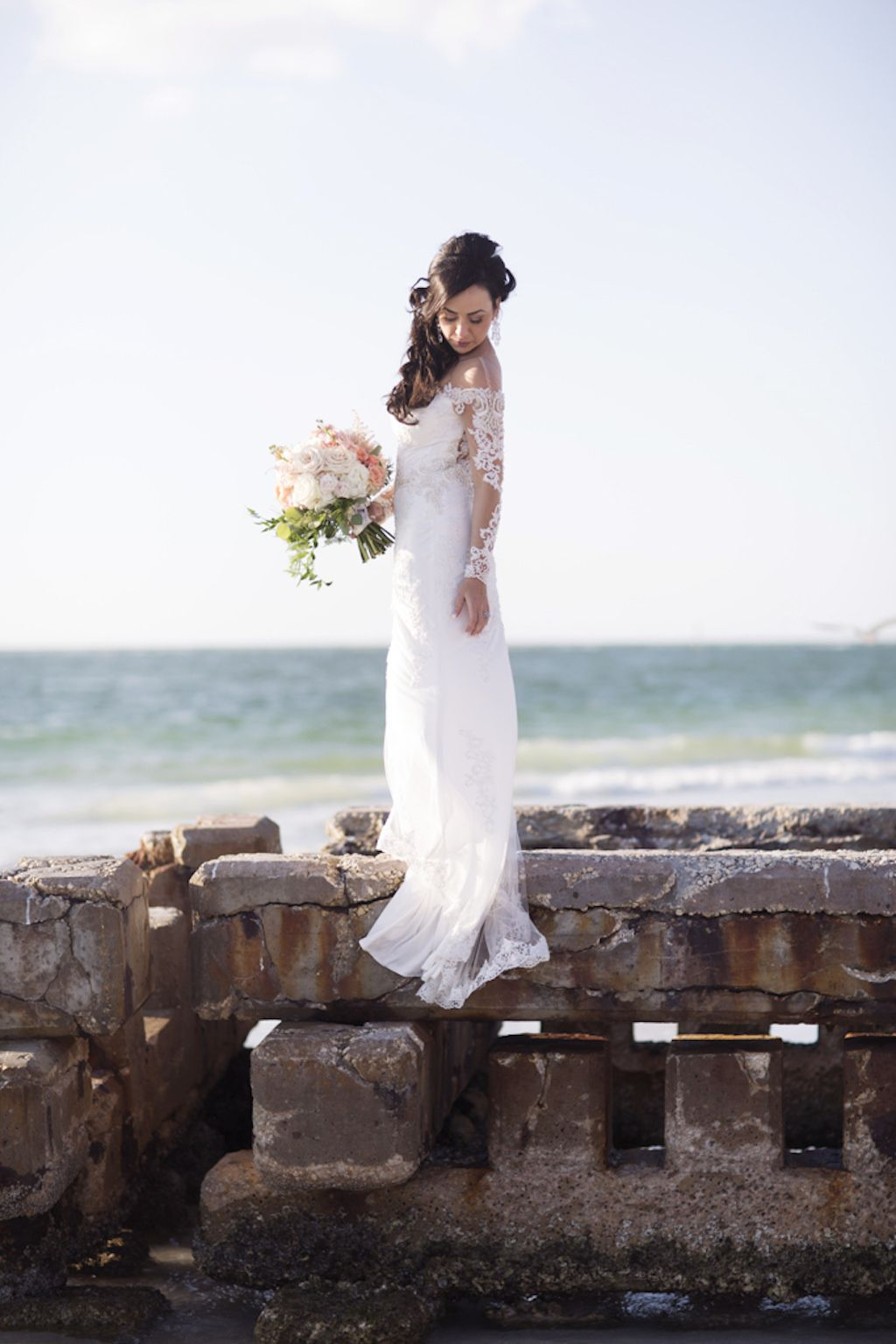 7ced4c0e89 Outdoor Beach Bridal Portrait, Bride in V Neck Off The Shoulder Lace Long  Sleeve Brides by Demetrios Dress with Pink and White Floral Bouquet with  Greenery ...