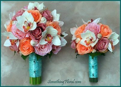 Coordinating, beach-themed bridal bouquet and bridesmaid bouquet of white orchids, pink, peach, and coral roses, and white sea shells. Both bouquets are wrapped in aqua satin ribbon and accented with teal and white pearls. With my colors n everything!!!