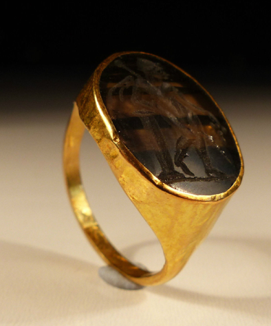 Roman Gold Ring,  with a large Carved Gem Stone Intaglio of a standing figure, 2nd century A.D.