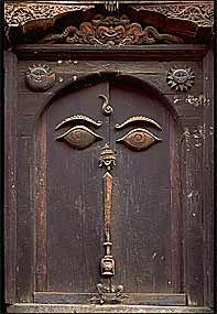 An ancient and typically lavish wood-carved doorway in Kathmandu town, Katmandu Valley, Nepal.