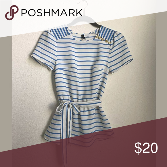H&M Nautical inspired striped top size 2 Brand: H&M  Size: 2 Condition: New Never Been Worn Style/Details: Nautical Inspired, Front Tie, Elastic Waist, Gold Button Deatail Color: White & Light Blue H&M Tops Blouses