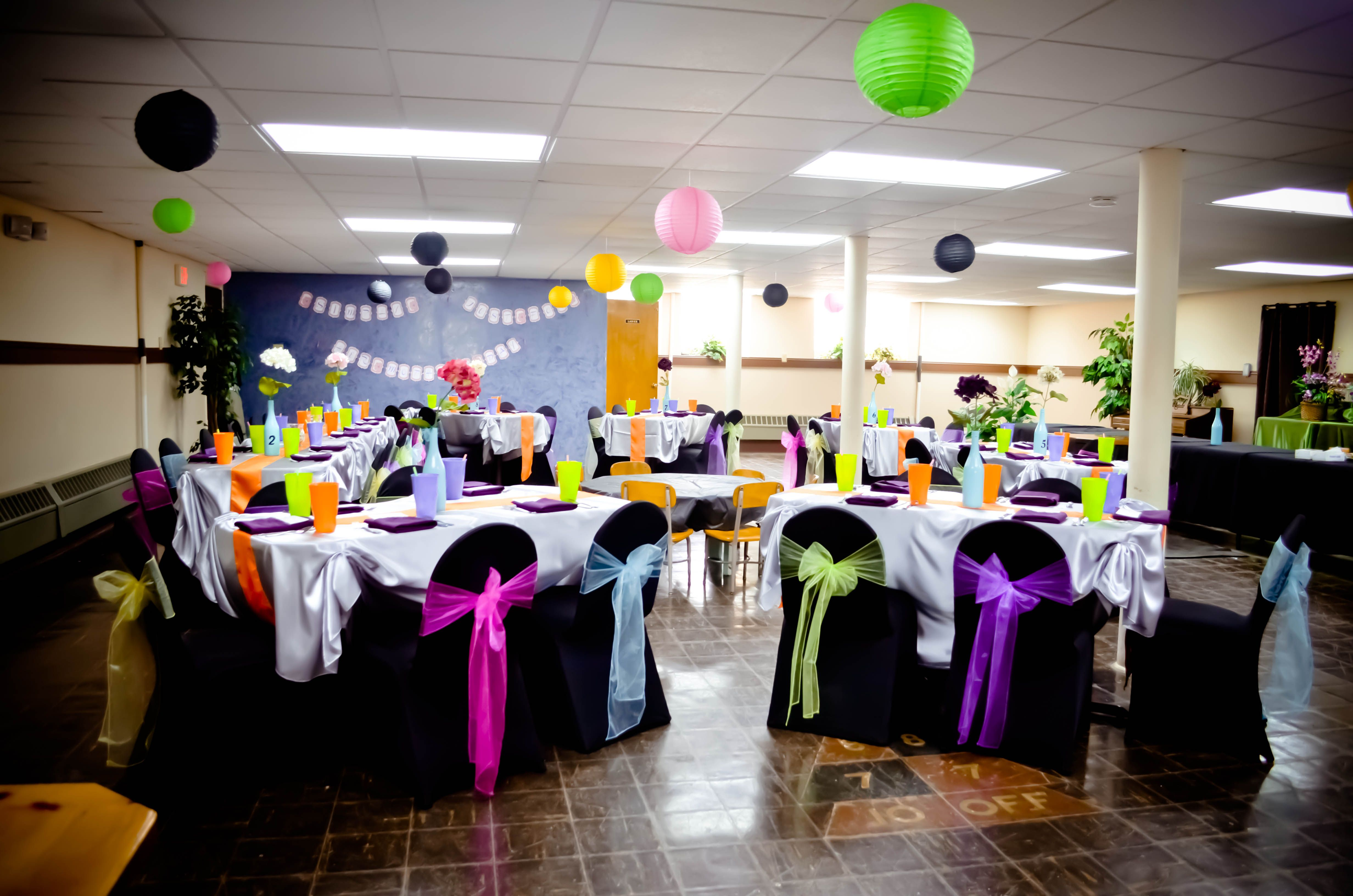 black white purple wedding reception%0A Party  Black Spandex Chair Covers  Silver Satin Tablecloths with Orange  Satin Table Runners