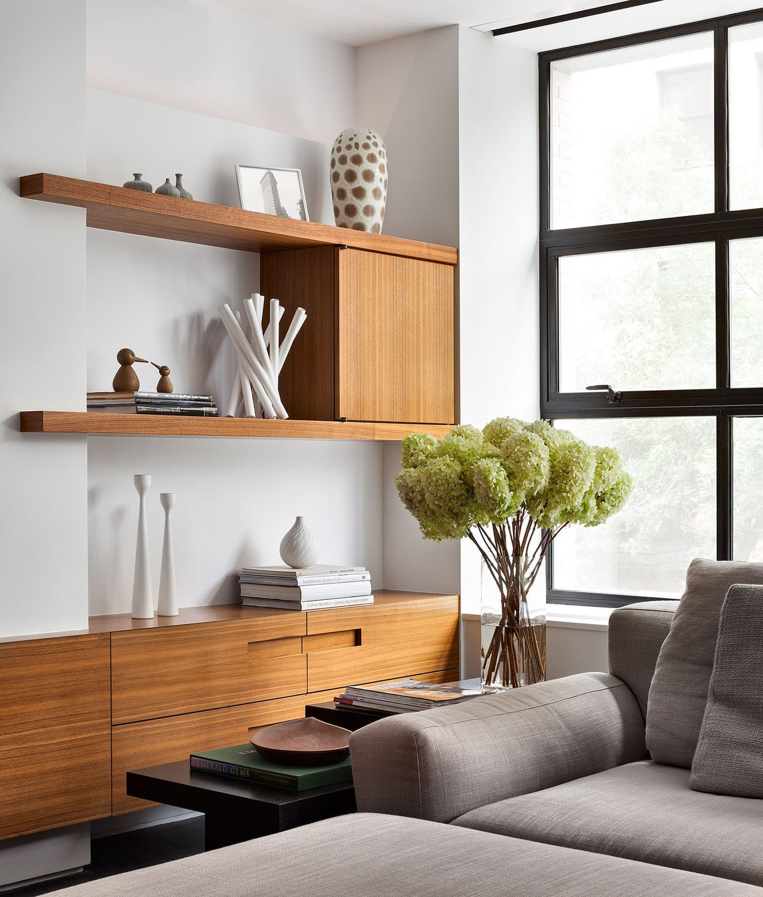 living room wall cabinets built%0A Floating builtin with shelves wrapping over a wall
