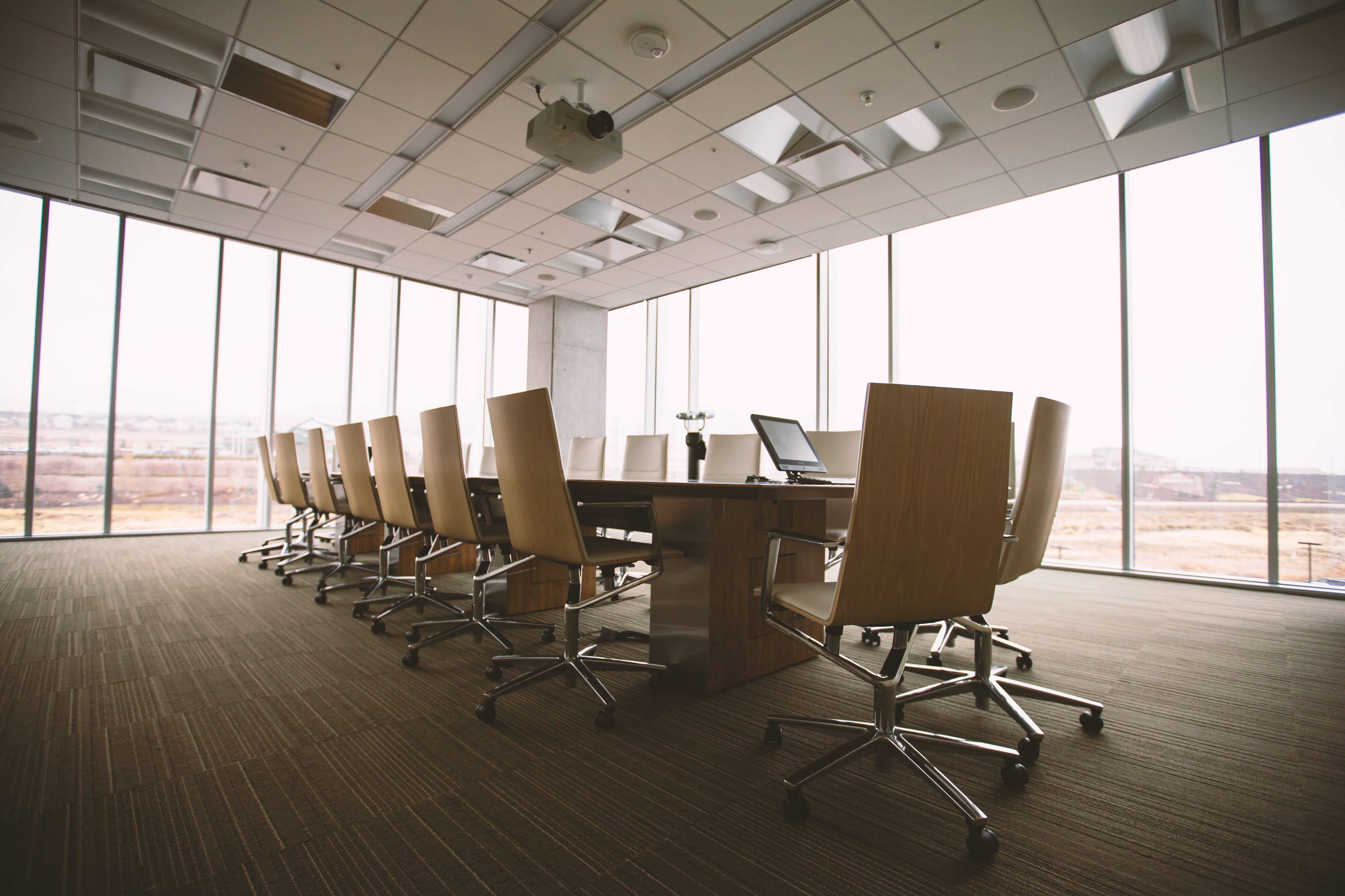 an empty boardroom with glass to ceiling windows photography rh pinterest com