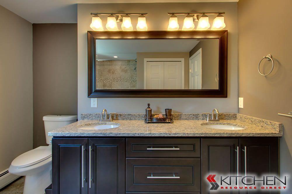 Bathroom Cabinets Espresso a master bathroom with espresso cabinets, dual sinks, and granite