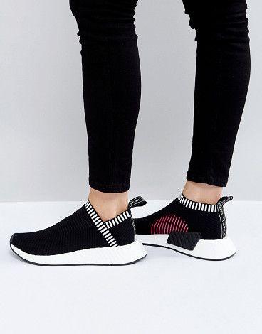 b692e8615 adidas Originals Black NMD Cs2 Primeknit Sneakers by adidas. Sneakers by  Adidas
