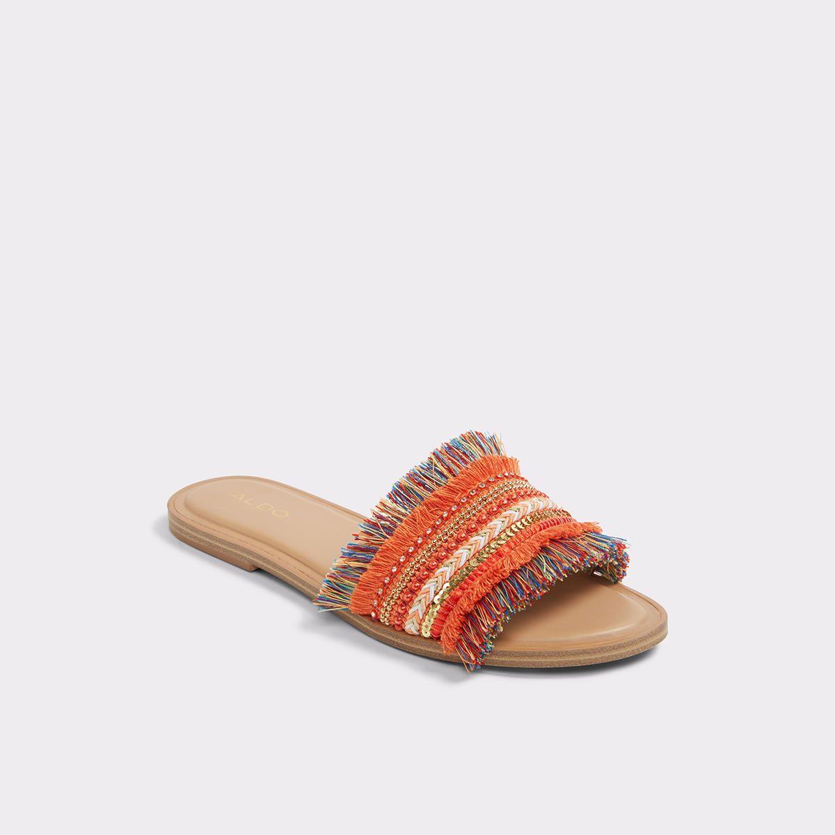 boho-inspired slide sandals exude