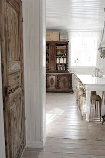Vintage Interior: Salvaged exterior doors used inside the home as closet doors.
