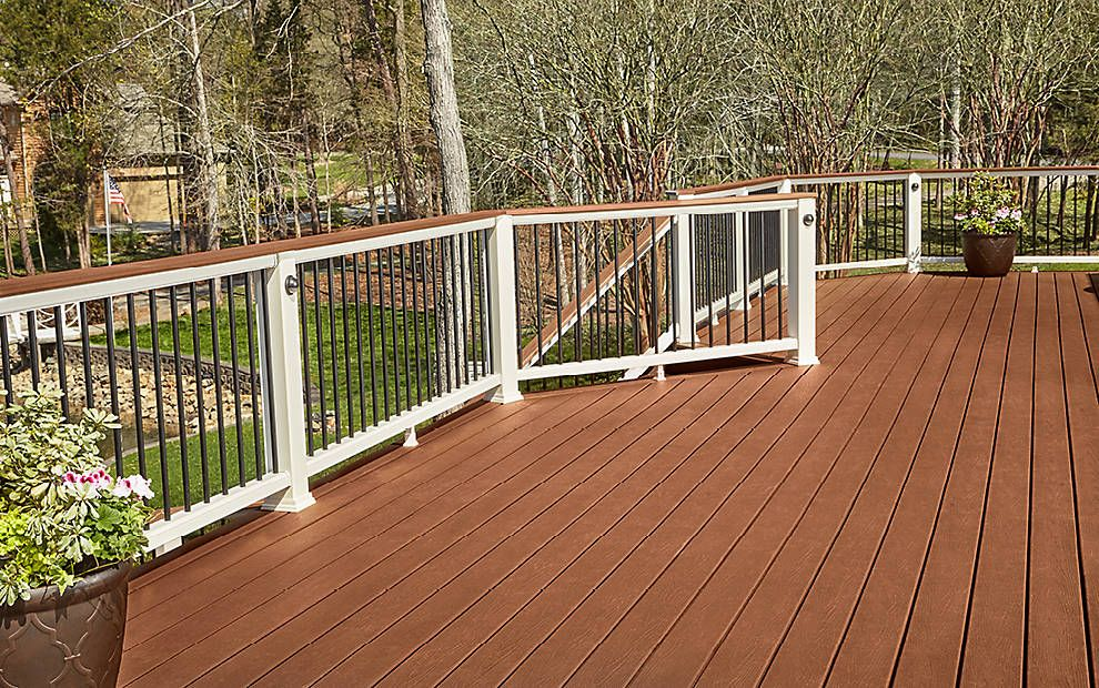 This Backyard Beauty Built With Trex Enhance Decking In Saddle And Trex Transcend Railing Will Never Go Out Of Style Deck Design Composite Decking Trex Deck