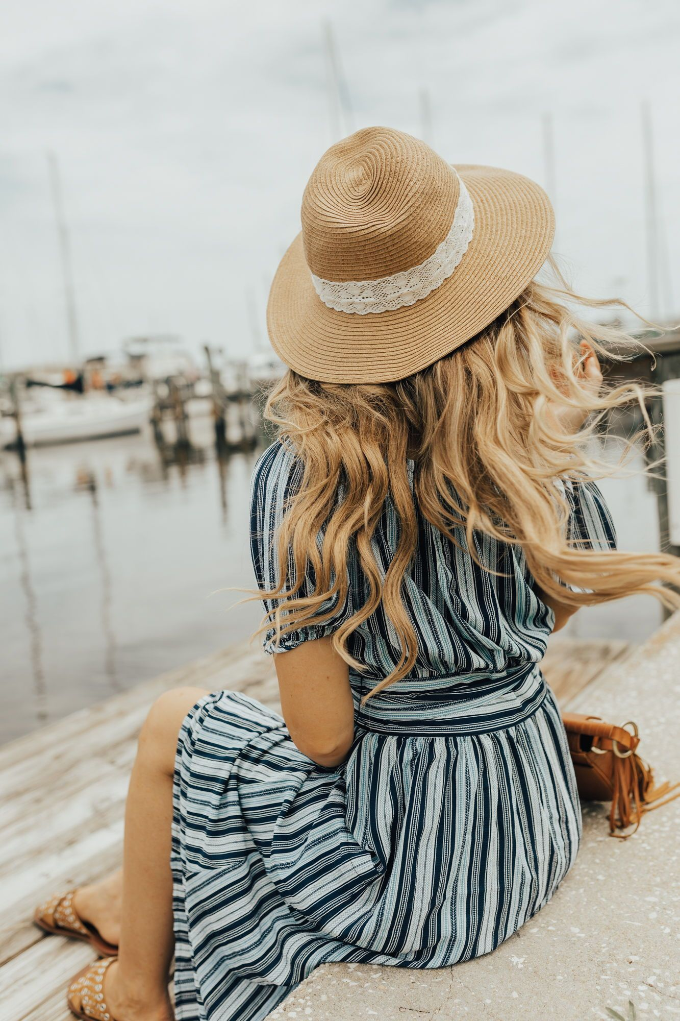 875caa78e30 Boho vacation outfit styled with striped off the shoulder maxi dress