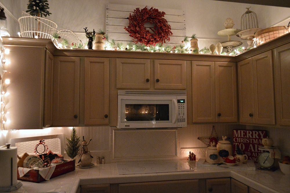 Fox Hollow Cottage Cozy Christmas Nighttime Home Tour | Kitchen, with twinkle lit upper cabinets