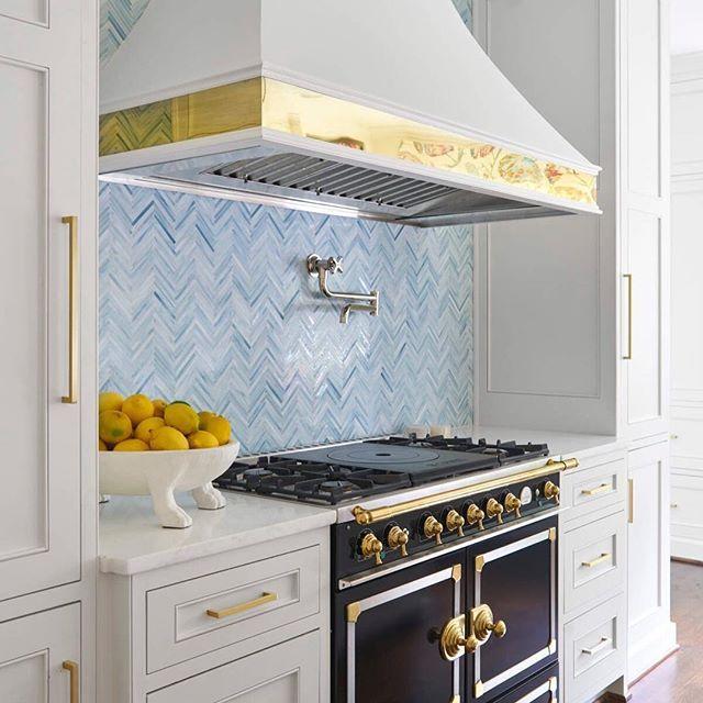 white cabinets with brass hardware light blue herringbone tile rh pinterest co uk